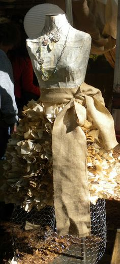 mannequin  with chicken wire skirt stuffed with book pages.