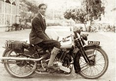 Man on antique motorcycle photo