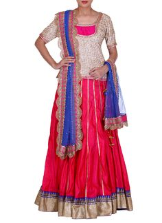 This simple yet appealing lehenga by Manjula Soni in a charming colour combination is a lovely pick for festive parties. It features a short sleeved white and gold embroidered choli with a round neckline. It has been complemented with a pink raw silk lehenga with thin golden panel design and heavy blue and gold embroidered borders. #indiandesignerlehenga #bridallengha #indianweddingclothes #weddinglengha #indianbridalclothes
