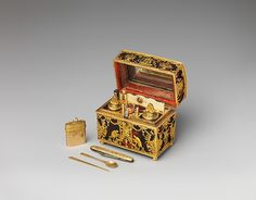 NécessaireFashionable in eighteenth-century Europe were so-called nécessaires de poche (pocket necessaries)—small caskets made of precious materials and fitted with tiny implements for grooming, writing, or sewing. Beneath a mirror-lined cover, the interior of this casket contains an inkwell and sand shaker, pen, pencil, clasp knife, cut-glass seal, snuff spoon, ear spoon, bodkin, tweezers, file, two-leaved ivory tablet, and a patch box.