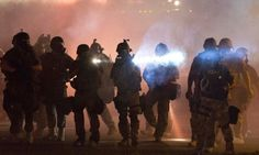 Ferguson Journalist arrested with protesters.  Police brutality
