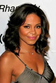 Sanaa Lathan does long, curly waves right with this fresh and sophisticated look.
