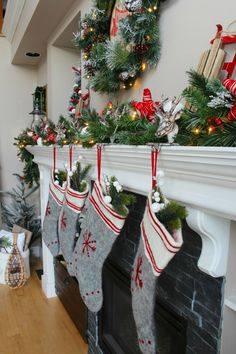 Cozy Christmas cabin Chirstmas mantel - snowy covered branches with red and white. #MerryMantels #sponsored @WayfairCanada