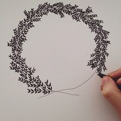 For me, this photo show, how simple a fine tip pen, piece of paper, a line, even made into a uneven circle, and start making lines with black 'leave' shape on them, suddenly turns into this beautiful wreath.  Sheesh, this photo really says it all. :)