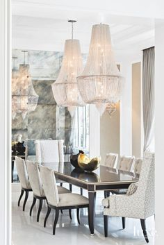 This is a dining room meant for a lavish party. Look at those chandeliers!
