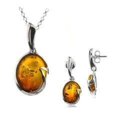 Sterling Silver Amber Oval Dangle Earrings and Necklace Set Rolo Chain 18 Inches GRACIANA. $50.00. All amber jewelry designs are from Eastern Europe