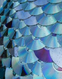 roofing out of used cds- this is going to look so cool on the potting shed!!! it may also blind a few birds- ouch.