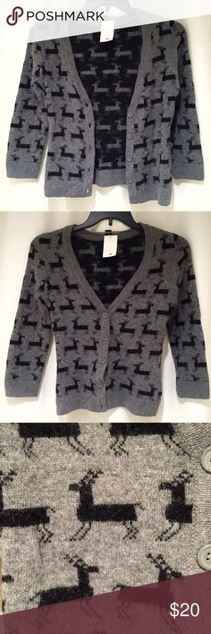 H&M Angora & Lambs Wool Reindeer Sweater Cardigan Brand new with tags, size XS. This H&M Angora & Lambs Wool Reindeer Sweater Cardigan is so soft and luxurious! Made of 60% Cotton, 20% Lambs Wool and 20% Angora. Grey cardigan adorned with black reindeers all over. Looks great worn open or buttoned up. 3/4 sleeves, V-neck. Missing the sweater belt that initially came with this. Still has the loops where the belt would go through. You can easily add your own sweater belt or just cut off the…