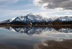 Pioneer Peak and surrounding mountains are reflected in standing water on the edge of Palmer Golf Course in Palmer, Alaska, on Wednesday, April 18, 2012.    AP Photo/The Anchorage Daily News, Marc Lester