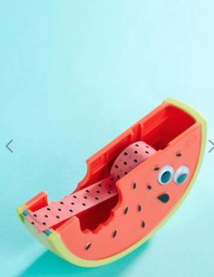 A nervy watermelon that isn't sure whether it wants you to take the tape or not. ASOS, £14