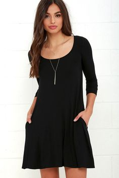 Who runs the world? With the Twirl Power Black Swing Dress it will always be you! Lightweight jersey knit sweeps across a rounded neckline and falls to fitted three-quarter sleeves. Comfy swing silhouette flares gently to a perfect finish. Hidden side seam pockets.