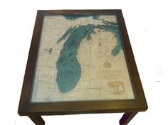 "Lake Michigan 3-D Wood Nautical Chart Coffee Table 34"" X 27.5"", http://www.amazon.com/dp/B00HWKTM46/ref=cm_sw_r_pi_awdm_aY7bub0BH6Q77"