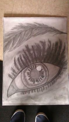 The feather eye-- one of my favorites. We were assigned to draw an object using a different object, so I chose to draw an eye made out of feathers. I used only pencil, paper, and my imagination!