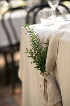 Add an element of surprise to the end of your table runner with a leaf sprig tucked inside a bow. It'll make your table ends pop!