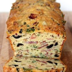 Olive, Bacon and Cheese Bread Recipe  Breads with white wine, olive oil, eggs, salt, all-purpose flour, baking powder, swiss cheese, onion, bacon, city hams, black olives, green olives, chopped parsley
