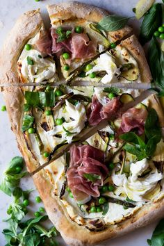 A delicious, fresh and light pizza with zucchini, prosciutto and asparagus. Use a cappello's naked crust to make it grain free, and kite hill ricotta.