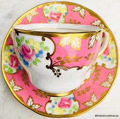 Stunning hot pink Salisbury tea cup and saucer featuring fancy gold scroll and floral details. Set is in excellent antique condition with no chips, cracks or crazing. ~~~~~~~~~~~~~~~~~~~~~~~~~~~~~~~~~~~~~~~~~~~~~~~~~ ~Complimentary antique sugar spoon included with every purchase~