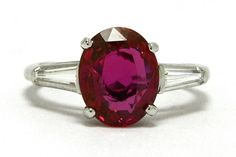 """This regal ruby engagement ring boasts a GIA certified 3.95 carat natural ruby of a deeply saturated red. So tantalizing, with a captivating hue and shimmering luster, the oval solitaire complimented by diamond baguette shoulders completed by a timeless platinum setting. Long valued by many cultures, in ancient Sanskrit, ruby was called ratnaraj, or """"king of precious stones"""". #heirloom #3stonering #3stonerings #threestonering #threestonerings #4carat #4carats #ruby #bigruby #bigrubies #diamond Engagement Rings 4 Carat, Engagement Ring Pictures, Estate Engagement Ring, Pear Shaped Engagement Rings, Engagement Ring Shapes, Perfect Engagement Ring, Antique Engagement Rings, Contemporary Engagement Rings, Gia Certified Diamonds"""