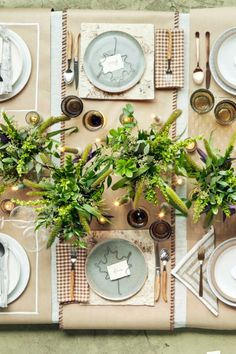 To create this DIY Rustic Leaf table setting, first put a 12- by 12-inch sheet of birch bark as a place mat atop a kraft paper runner with whipstitched edges.  A gingham napkin, ceramic plate, and wood-accented flatware complete the look.