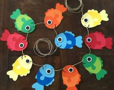 Best 11 This is the perfect addition to any Fish themed party! This listing is for a banner featuring Fish. Each Garland strand comes with 10 fish. This can be hanged vertically or horizontally! The main colors are red, orange, yellow blue and green. Under The Sea Decorations, Hawaiian Party Decorations, Birthday Decorations, Whale Crafts, Fish Crafts, Dinosaur Crafts, Ocean Crafts, Toddler Crafts, Preschool Crafts