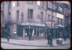This photo is labelled Bowery and 1st Street, and the time is likely the mid-1940s. In that era the Third Avenue El ran up The Bowery, but for the most part, it left the sidewalks in full sun. 295 Bowery, McGurk's Suicide Hall, is just out of the picture on the right. This entire block is now dominated by the gleaming Avalon Bowery Place.