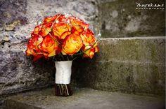 burnt orange roses as part of bouquet September Wedding ideas