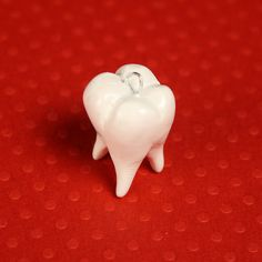 I really kind of love this wisdom tooth charm. It also comes in silver. $10