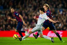 Tiago Mendes of Club Atletico de Madrid plays the ball close to Ivan Rakitic of FC Barcelona during the La Liga match between FC Barcelona and Club Atletico de Madrid at Camp Nou on January 11, 2015 in Barcelona, Catalonia.
