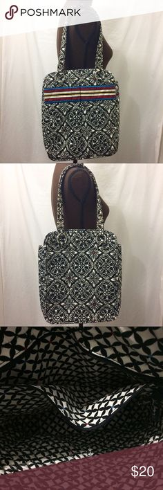 Vera Bradley Tote Black and white with multicolor accents. 2 front pockets. 1 zipper pockets inside. Some discoloration from use. Please see pictures. Height 14 inches. Width 12 inches. Depth 3.5 inches. Vera Bradley Bags Totes
