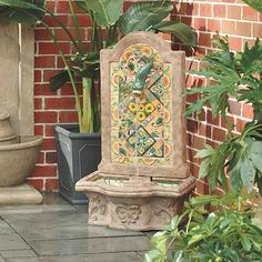 Inspired by the vibrant colors of Tuscany, our Chianna Fountain is hand crafted of high-fired ceramic tiles set by hand into the backsplash and basin. A ceramic carp releases water from its mouth in a gentle stream. Cement base is decorated with acanthus relief and finished to resemble weathered stone. Includes pump and 6' 110V plug-in cord. Because each is handmade, expect variations. Avoid extreme temperatures.