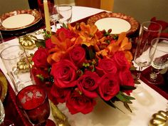 Go for ravishing red in your Thanksgiving centerpiece this season. #thanksgiving #decorating #flowers #roses