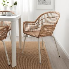 NILSOVE Chair with armrests, rattan, white. Hand-woven rattan and sturdy bamboo make each armchair unique and stable. A great way to invite nature into your home. Ikea Dining Chair, Ikea Armchair, White Armchair, Dining Room Sets, Ikea Table And Chairs, Swivel Chair, Ikea Dining Table, Eames Chairs, Modern Armchair