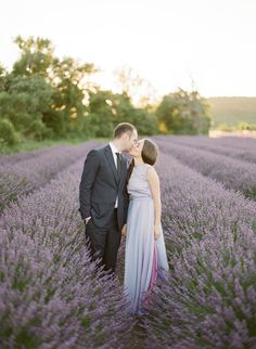 A Provence Engagement Session in Fields Lavender - http://www.stylemepretty.com/2015/07/31/a-provence-engagement-session-in-fields-lavender/