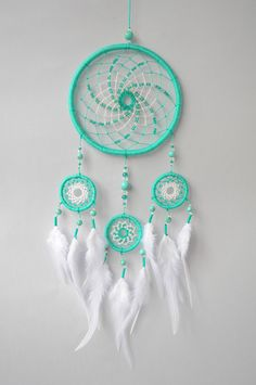 ✪ DREAMCATCHER MINTY BREEZE Medium size dream catcher in tender turquoise and white hues. Wall hanging will be good additional as decor to interiors in boho and hippie styles, for nurseries and as weeding decoration. For decoration were used high-quality turquoise beads and glass crystals.