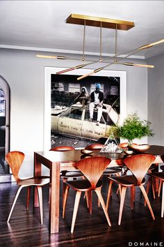 Modern dining room with taxi artwork and wood chairs