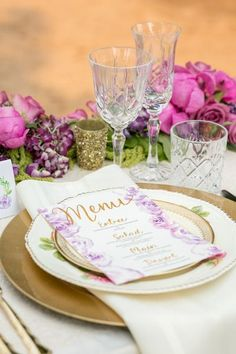 Floral and gold themed wedding place setting