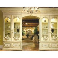 Biltmore was first and foremost a home. It was also an oasis for founder George Vanderbilt?s family and friends to retreat from city life to a timeless world of elegance and refinement. Designs like this stunning display cabinet from the Biltmore Chateau Reserve Collection truly reflect the architecture and ambiance of the estate. The center unit offers three adjustable wood frame glass shelves, two lights, and two drawers. Each end includes one light, three adjustable wood framed glass…