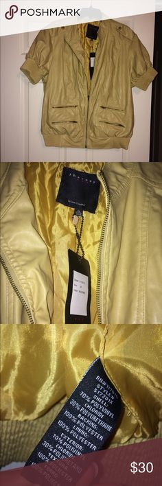 Mustard yellow shirt sleeved jacket Short sleeved mustard colored yellow jacket. The jacket zips close and has elastic at the waist. The jacket is a 2X but really fits more like a 1x. Jackets & Coats Blazers