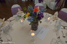 Lovely centerpiece with delphinium, gerbera daisies, bupleurum and hydrangea