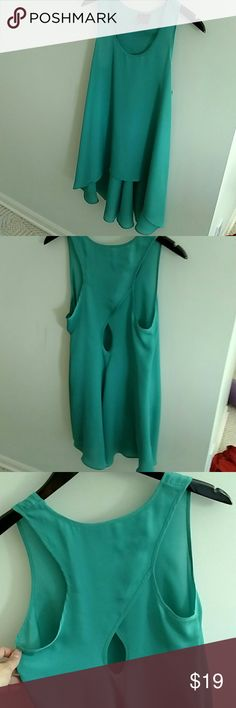Flowy Keyhole Tunic Beautiful semi sheer flowy tunic, perfect to wear with leggings or skinny jeans.  Vibrant turquoise color, so pretty!  In excellent condition, like new. Fire Los Angeles Tops Tunics