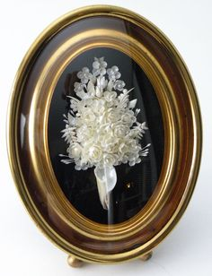 Vintage Off-White Floral Bouquet of Miniature Sea Shells Brass Oval Convex Frame