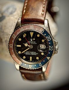 Vintage 1975 Rolex GMT Master Ref.1675 with Pepsi bezel and custom leather strap by Star Dot Creations.