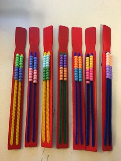 Rekenreks: donated paint mixers, beads, chenille sticks 1st Grade Math, Math Class, Kindergarten Math, Grade 1, Maths, Cub Scouts Wolf, Number Talks, Diy Pipe, Painted Sticks