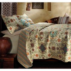 @Overstock - Exotic and whimsical with motifs inspired by modern art, the Esprit quilt set provides a perfect accent to a bohemian lifestyle. Quilted in a stylized daisy-chain stitch pattern, the oversized set reverses to a coordinating all-over stripe.http://www.overstock.com/Bedding-Bath/Esprit-Spice-3-piece-Quilt-Set/6823005/product.html?CID=214117 $69.99