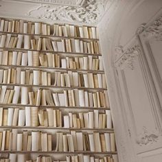 Bookcase Wallpaper - Natural - J43027  This fantastic bookcase style wallpaper gives a modern twist on traditional wallpaper. The high quality wallpaper recreates the look of a bookcase complete with realistic books in a variety of textures for added 3D effect. Easy to apply, this wallpaper will look great when used to decorate a whole room or to create a feature wall. Designer wallpaper Contemporary bookcase design with white and cream books Ideal for feature walls and entire rooms 10m…