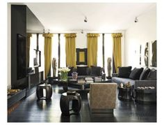 Designer Kelly Hoppen's living room...love the dramatic darks w/pop of color