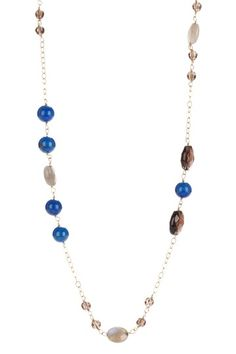 "$1200   - 299   14K yellow gold round lapis and faceted smokey quartz necklace  - Lobster clasp  - Approx. 36"" chain length  - Approx. 4-8mm beads  - Made in USA    Materials  14K yellow gold, lapis, smokey quartz"