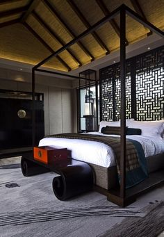 Black, White, Red are very contemporary and great color tones to create a very positive & meditative aura to the room.  Suite decor at Lijiang Pullman Resort & Spa Hotel, Lijiang, China.