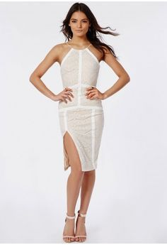 This luscious lace midi dress is a dream this season.  With halterneck cut, chic cream panelling and a seriously seductive front spilt this dress is the ultimate party dress. Style high with nude strappy heels and matching clutch for a stan...