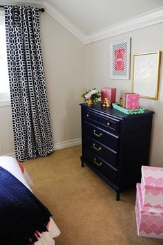 Keep clutter in your kid's bedroom at bay with cute fabric covered stacking boxes like these pink ones from HomeGoods.  They are big enough to to hide dress-ups, stuffed animals, and any other treasures that your kids don't want to part with.  They make room clean up a breeze. Sponsored post.